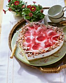 Heart-shaped yoghurt & cherry gateau with grated chocolate