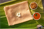 Polo dosa (rice flatbread with ghee and coconut flakes, India)