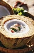 Tom Yang soup: chicken and coconut soup in coconut half