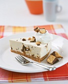 A piece of cheesecake with chocolate crispies