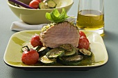 Tuna on a bed of tomatoes and courgettes