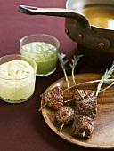 Fondue with lamb and various dips