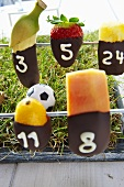 Table football with chocolate-dipped fruit