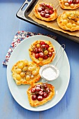 Sweet mini-pizzas topped with grapes and rosemary