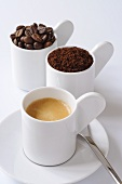 Espresso, ground coffee and coffee beans in cups
