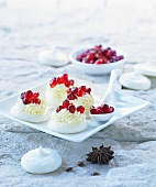 Meringues with cream and pomegranate seeds