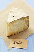 Piece of Bigio cheese (Italian hard cheese) on paper