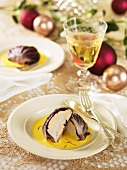 Scallops wrapped in radicchio leaves on saffron sauce