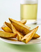 Potato wedges with a glass of beer