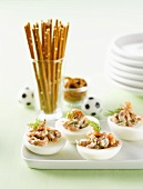 Eggs stuffed with shrimps and dill, salted sticks (football theme)
