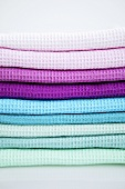 Pile of different-coloured tea towels