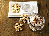 Christmas biscuits in and beside storage jar