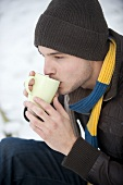 Young man drinking cocoa