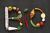 The word 'BIO' written in vegetables, fruit, herbs and other foodstuffs