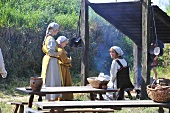 Girls in Viking costume in reconstructed village