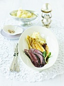 Venison fillet with chicory and elderflower butter