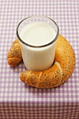 Poppy seed croissant and glass of milk