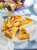 Apple cheesecake on cake stand