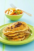 Pancakes with dried tomatoes, tomato salad