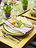 A place setting at a table laid for Easter