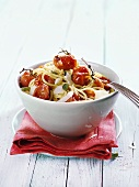 Spaghetti with backed cherry tomatoes and Parmesan