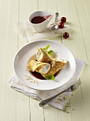 Stuffed crepes with cherry sauce