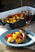 Oven-baked sausage and potatoes