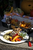 Roasted lamp chops with a pumpkin medley and couscous