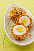 Boiled eggs in almond and carrot crust