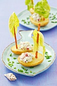Potato boats with soft cheese, radishes and cucumber
