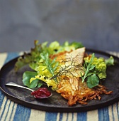Salad leaves with smoked trout and potato rosti