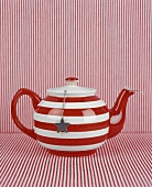 Striped teapot with tea ball