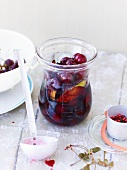 Pepper cherries in a preserving jar