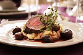 Roast beef on a bed of mashed potatoes