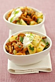 Fried potatoes with chanterelle mushrooms and sour cream