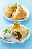 Puff pastry samosas stuffed with chicken, spinach and raisins