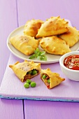Stuffed pastry parcels with ham, peas and pepper
