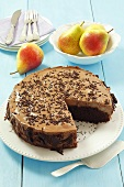 Chocolate cake with pears and chocolate mousse, sliced