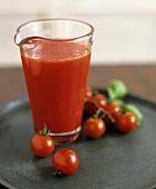 A glass jug of tomato juice