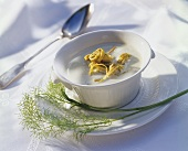 Cream of fennel soup with strips of herb pancake