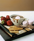 Chocolate fondue with strawberries, marshmallows & biscuits