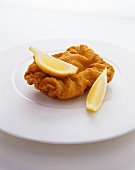 Wiener schnitzel (breaded veal escalope) with lemon wedges