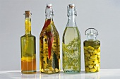 Four bottles of flavoured oils