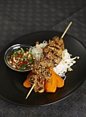 Pork kebab with rice noodles and carrots (Asia)