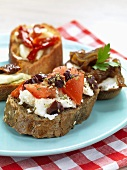 Canapes with tomatoes, feta, onion and pepper