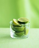 Halved limes in a glass