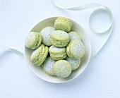 Green tea macarons with icing sugar