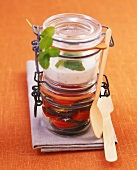 Fried aubergine slices in preserving jar with yoghurt dip