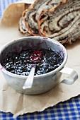 Homemade blueberry jam in a tin mug