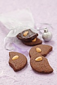 Moon-shaped chocolate and almond biscuits